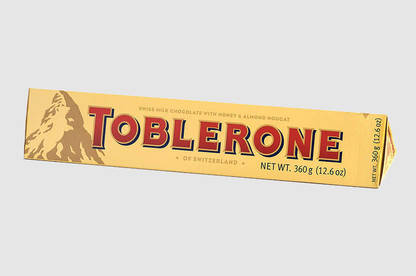 A Toblerone Gold bar cost $16 at duty free and $11.50 at Kmart.