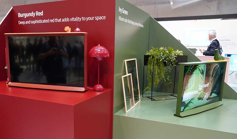 Samsung Serif TVs on display at IFA Berlin in Burgundy Red and Ivy Green.