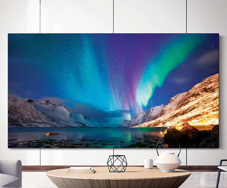 Samsung's The Wall TV mounted on a wall at home.