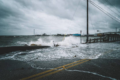 Water crashing over bridge