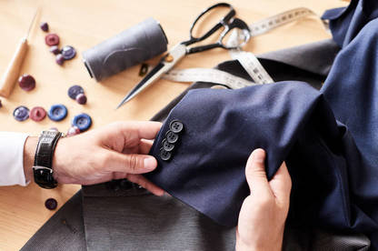 Man fixing buttons on jacket