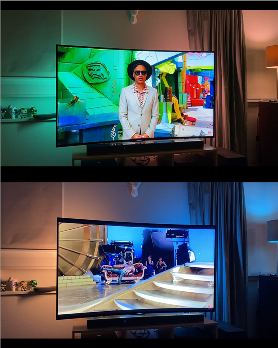 A scene showing how the Hue Play lightbars work behind a TV screen.