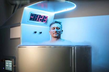 Man in cryotherapy chamber.