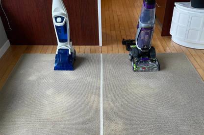 Both carpet washers aligned on the rug.