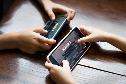 Kids playing a game on their mobile.