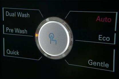 Close up of washing machine controls.