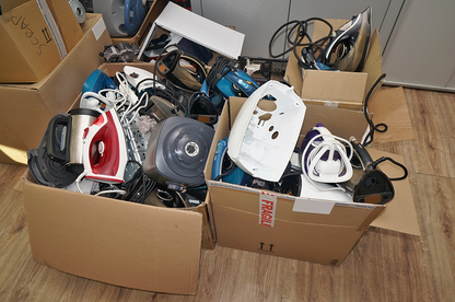 Parts of appliances in boxes.