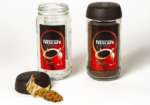 Photograph of a Nescafe jar.
