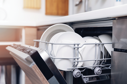 Close up of open dishwasher.
