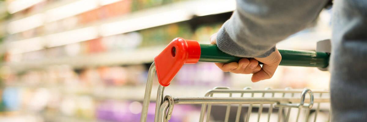 Supermarket trolley in aisle