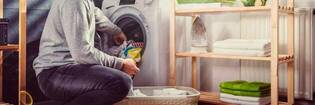Man loading washing machine.