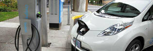 White Nissan Leaf charging