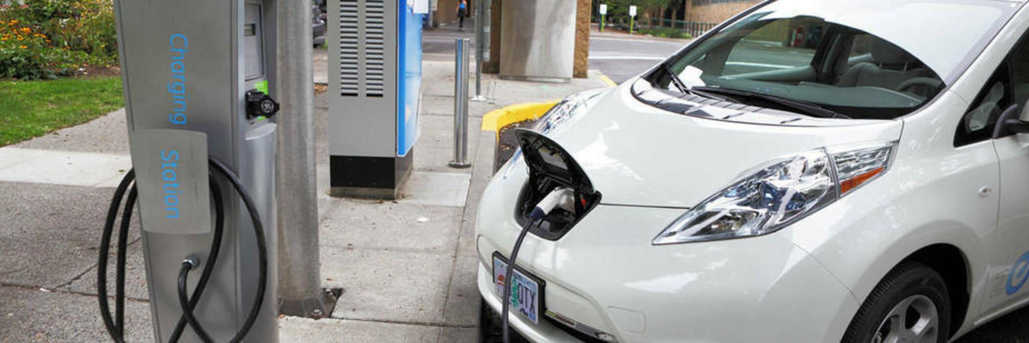 White Nissan Leaf charging