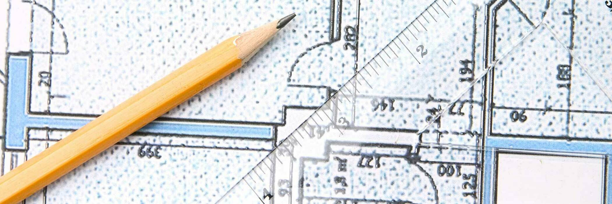 Pencil and ruler on house plan