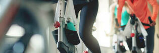 Woman on cycle machine at the gym