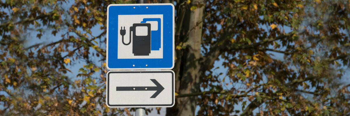 Electric vehicle charging station sign.