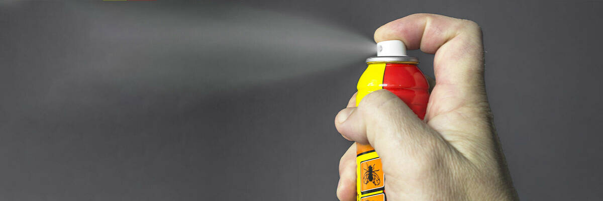spraying a can
