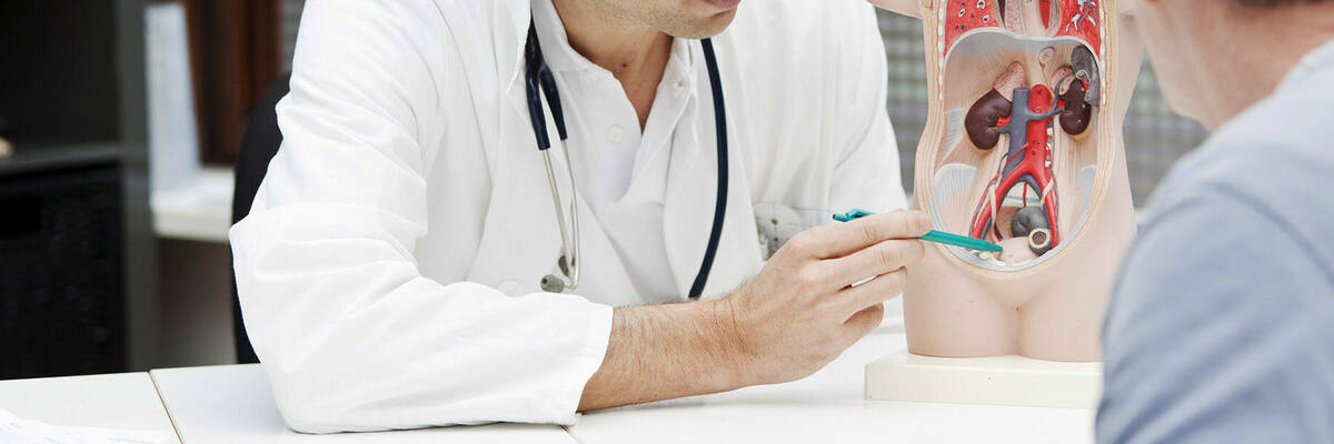 Doctor explaining UTI symptoms to patient