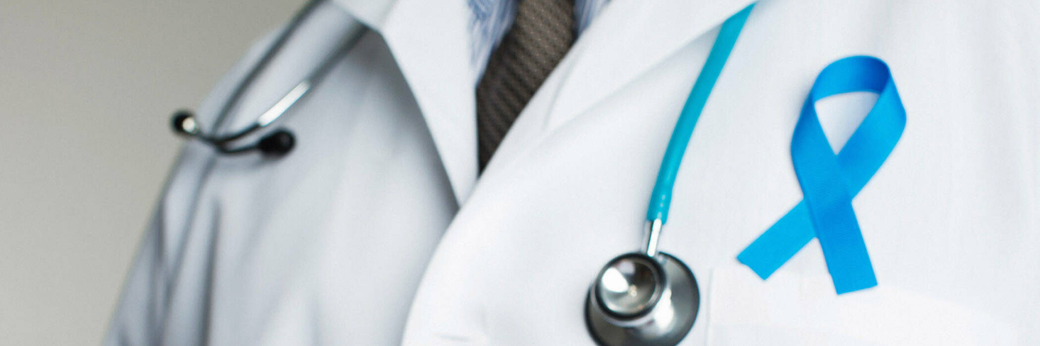 Doctor wearing prostate cancer ribbon