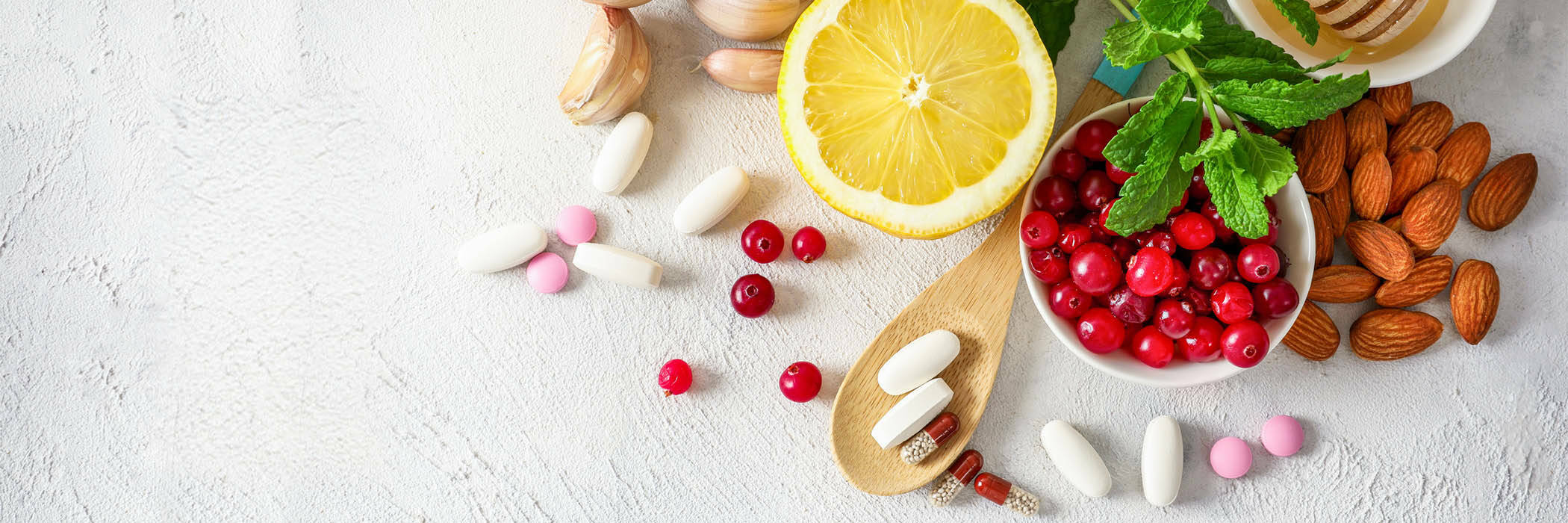 Various healthy natural products for immunity boosting and cold remedies on white background.
