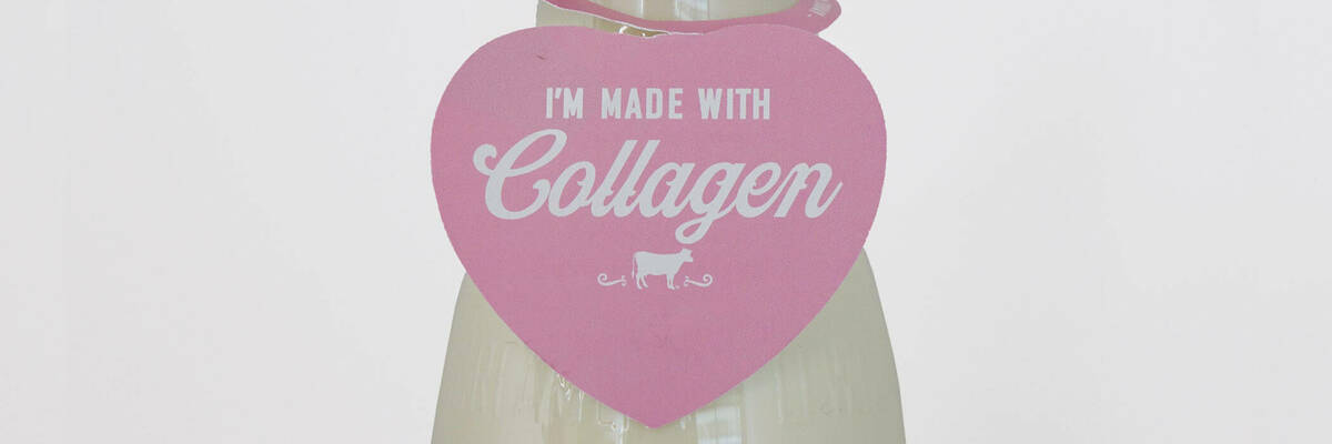 """I'm made with Collagen"" label on milk bottle."