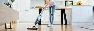 Vacuuming floor in the living room.