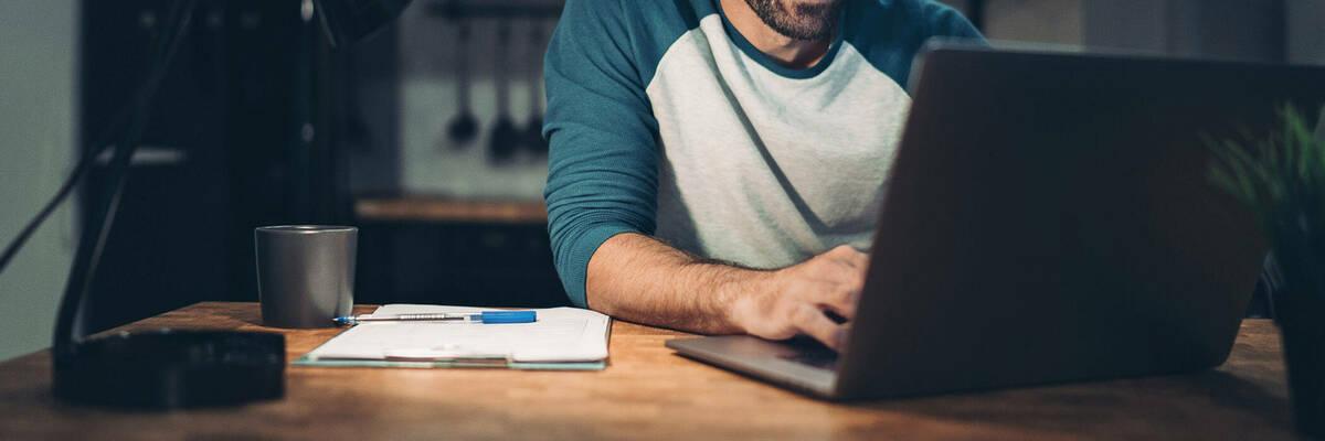 Man working on his laptop.