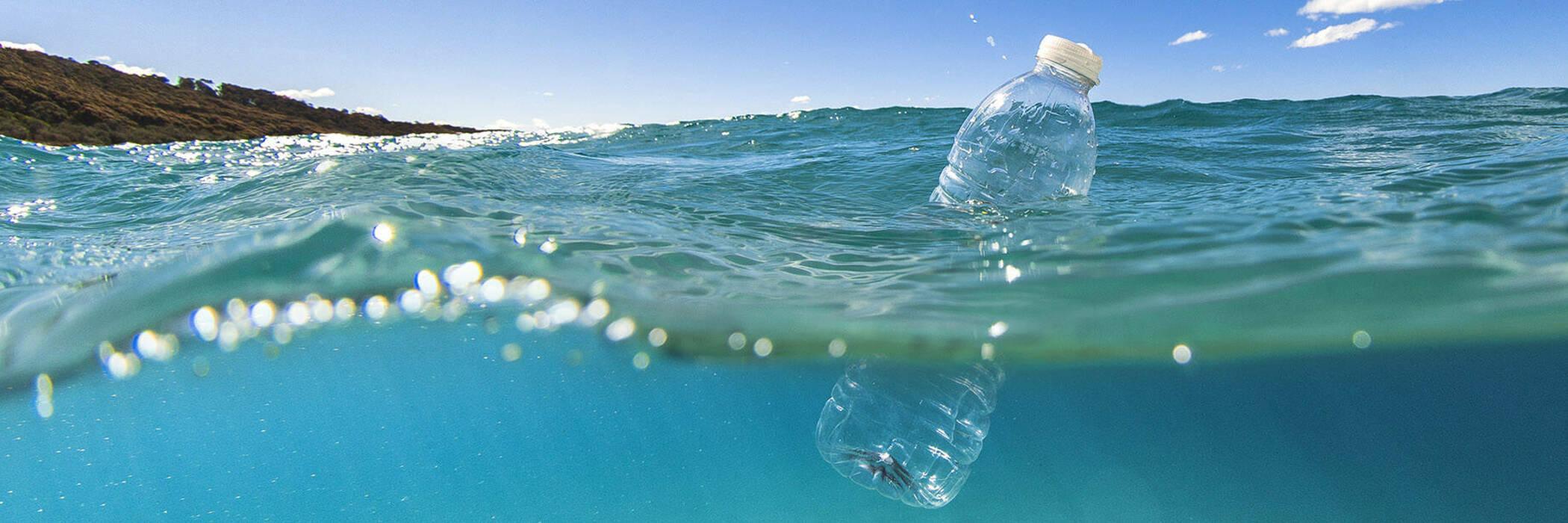 Plastic bottle floating in water