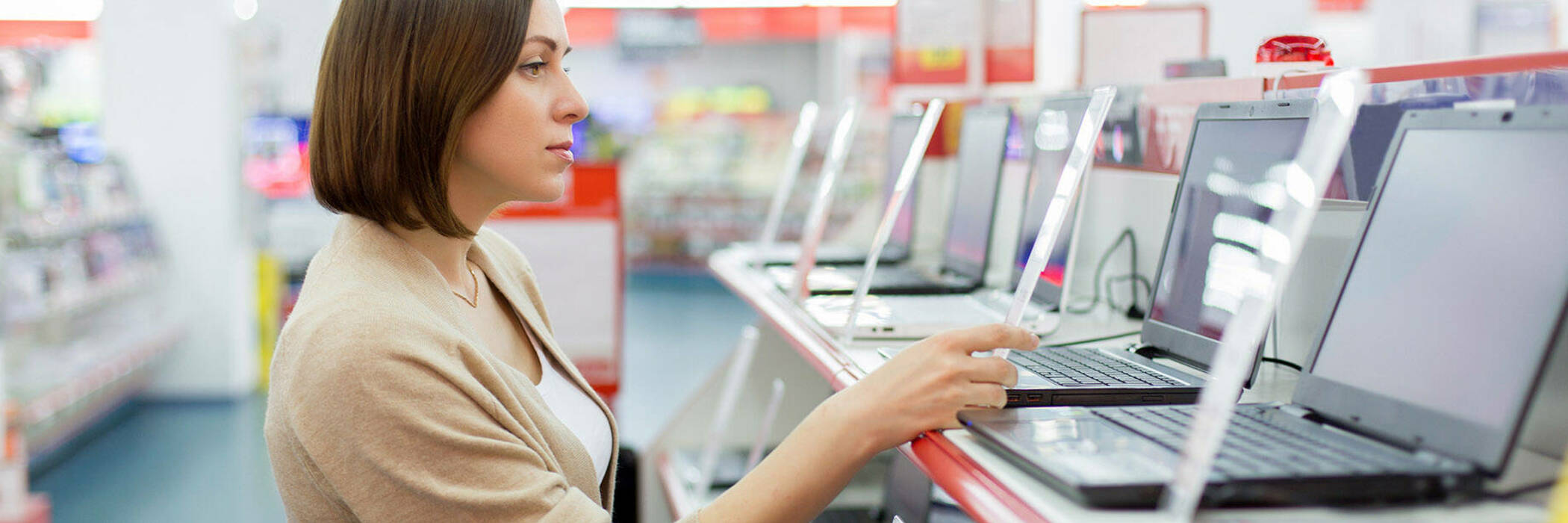 Woman shopping for laptop