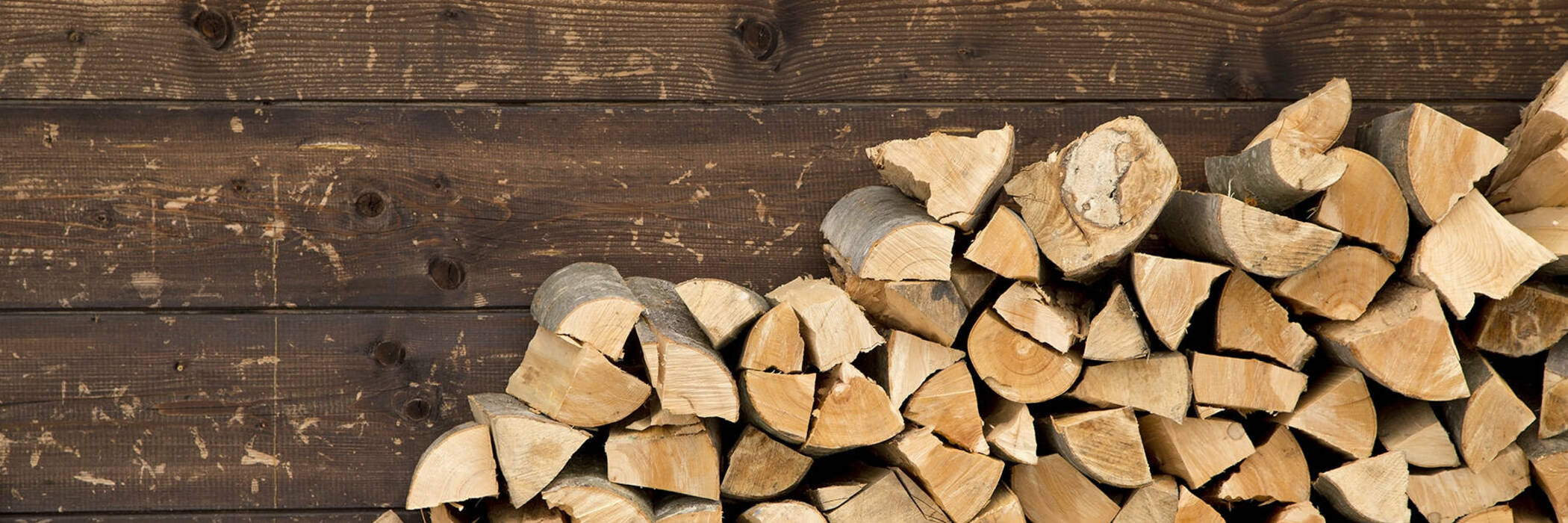 Firewood stacked against wall.