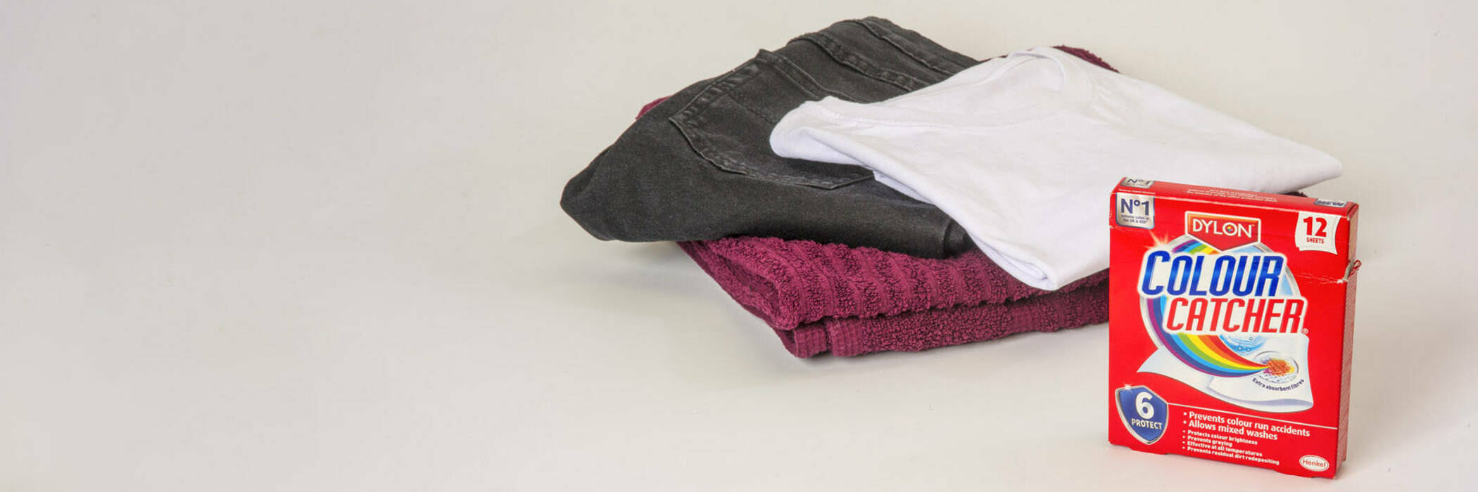 Dylon Colour Catcher box with red towel, black jeans and white shirt