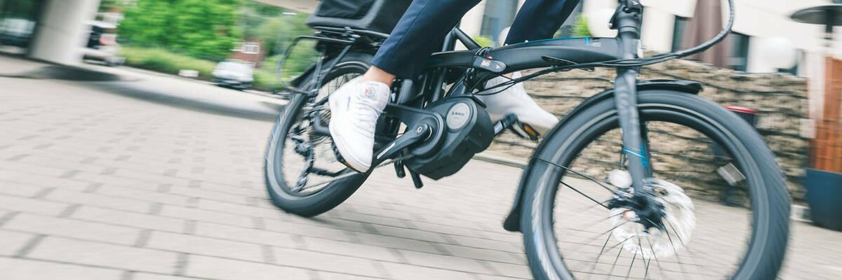Commuter riding Vektron e-bike