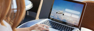 Woman searching for flights online