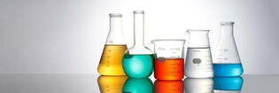 lab beakers with coloured liquid