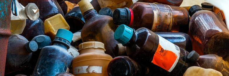 Old containers of hazardous chemicals
