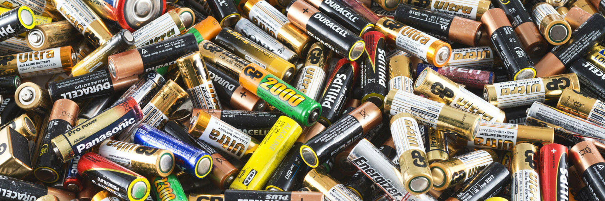 Recycling logo and used batteries