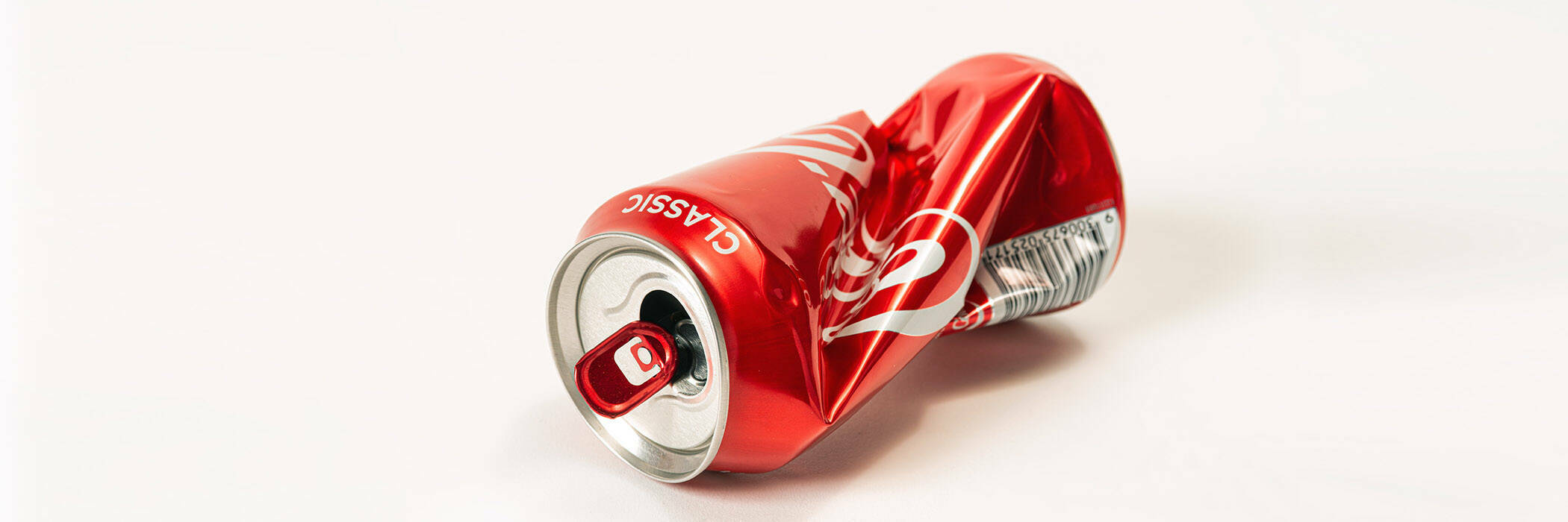Crushed can of Coca Cola.