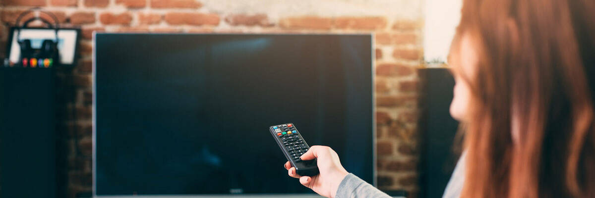 woman with TV remote