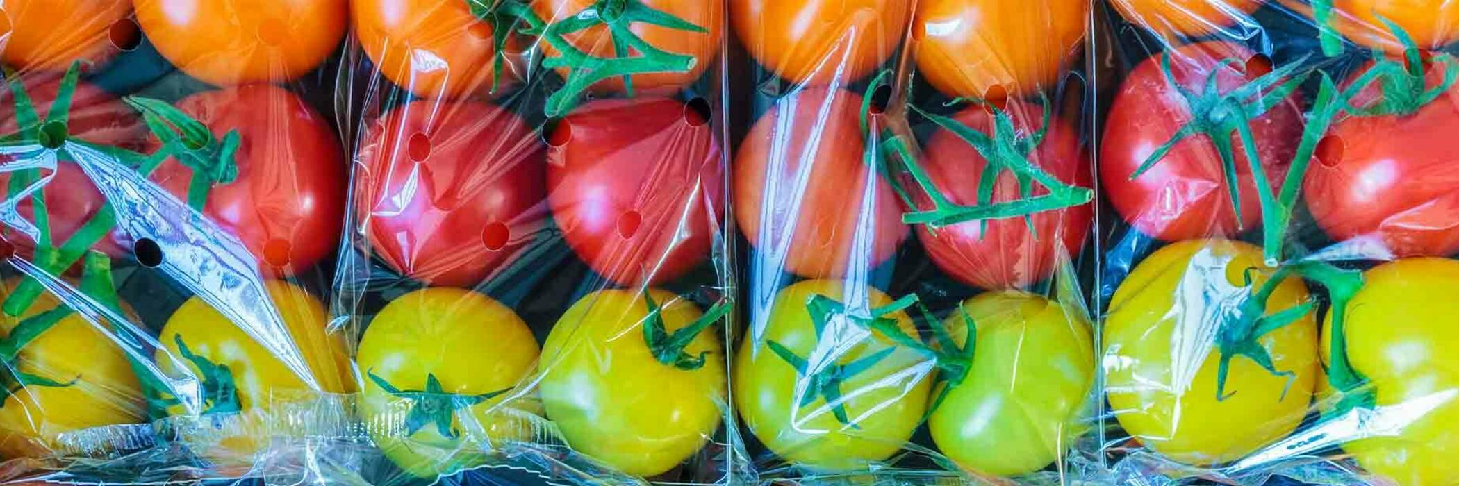Tomatoes packaged in plastic.