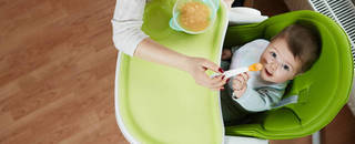Child eating in high chair
