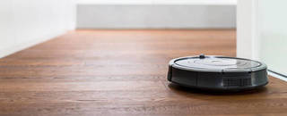 Robot vacuum cleaner on wooden floor