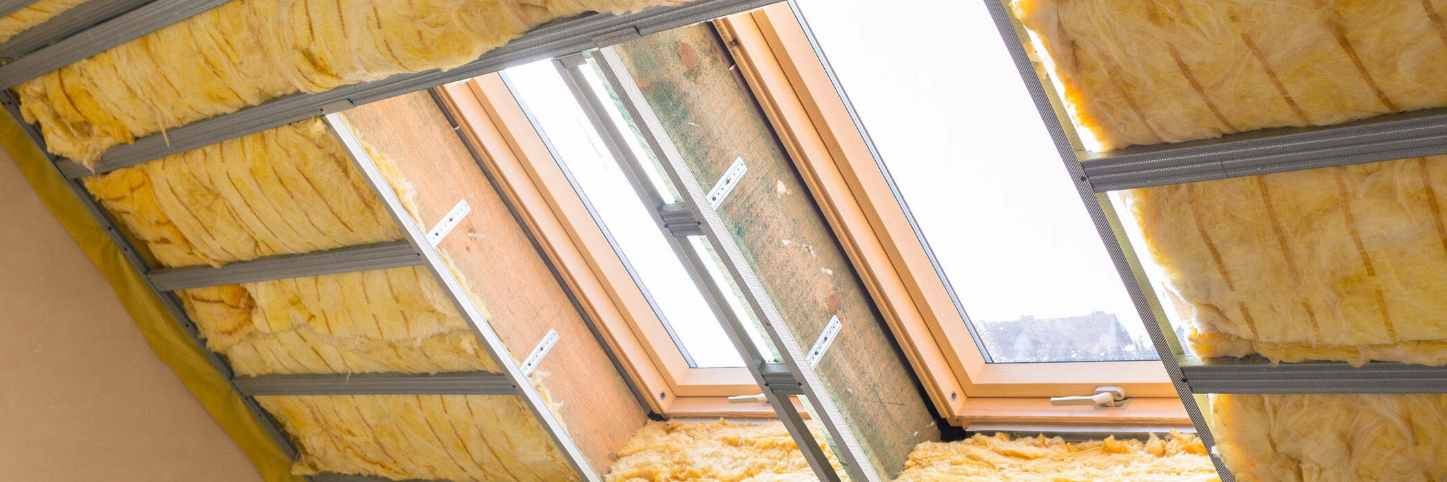 Man installing insulation.