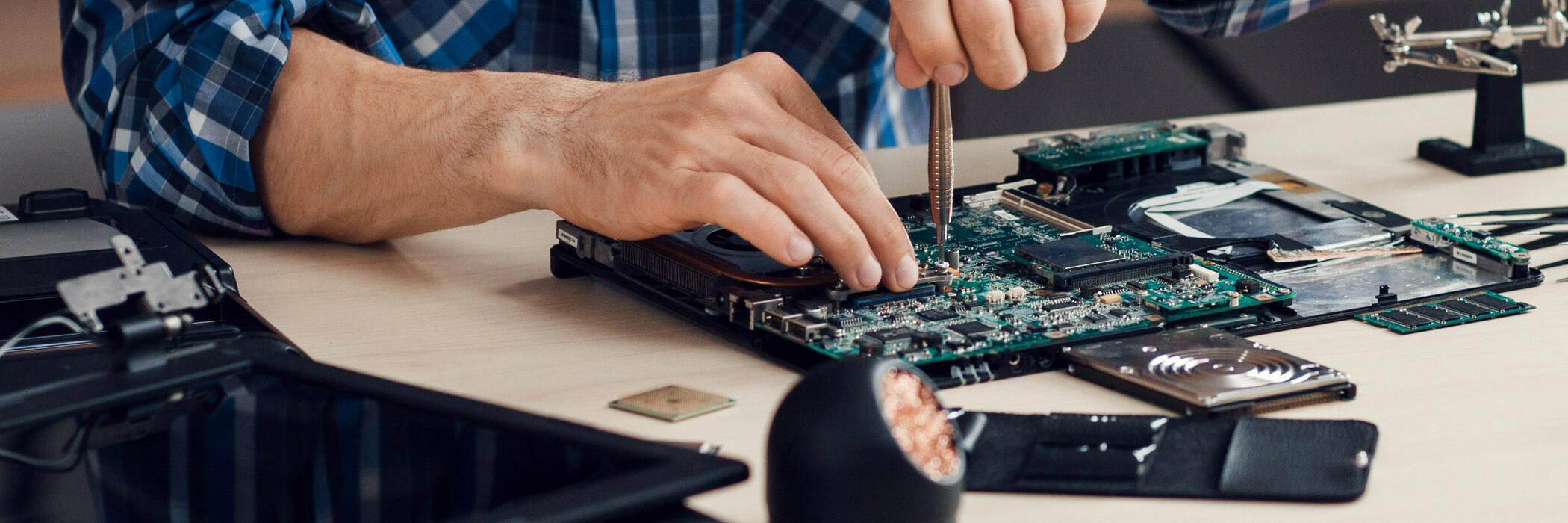 man repairing a laptop
