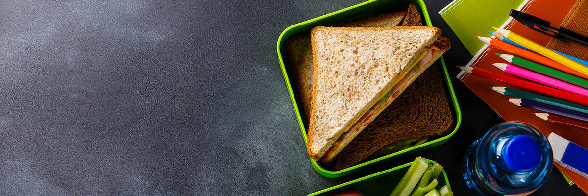 Lunchbox with sandwich and fruit and veg