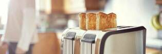 Two slices of toast in toaster.