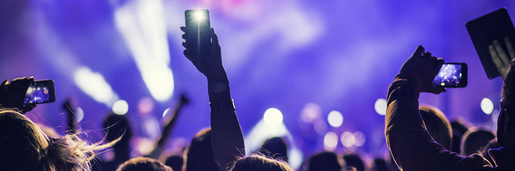 people recording a concert