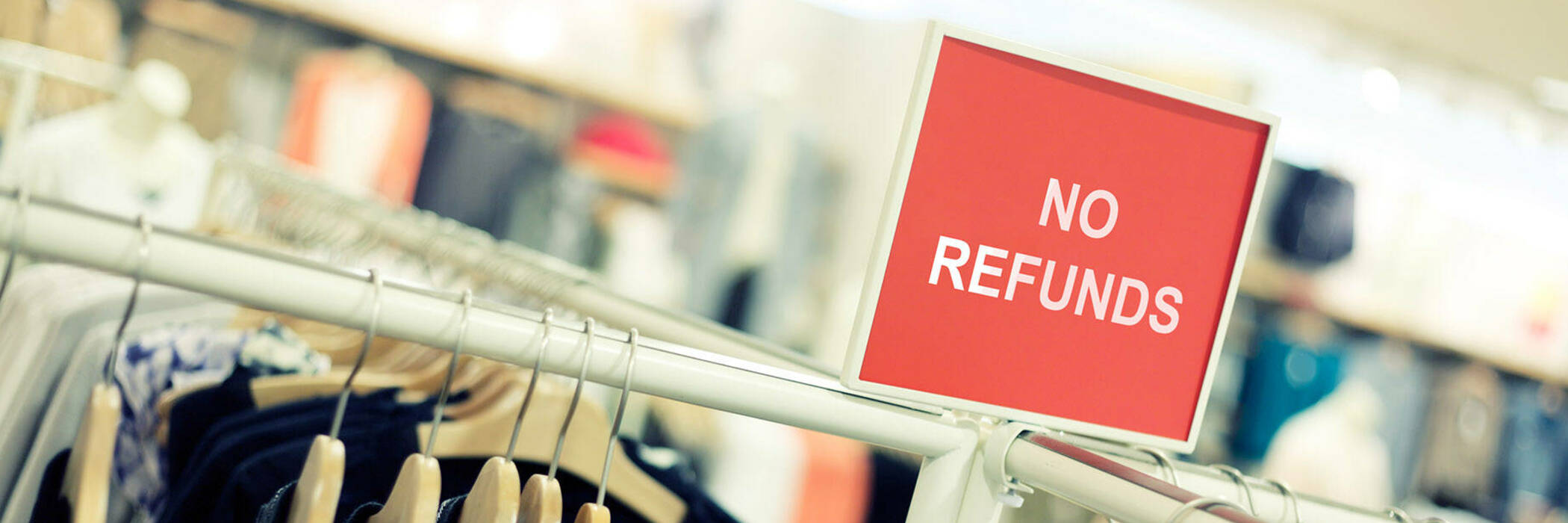 """""""NO REFUNDS"""" signage in shop"""
