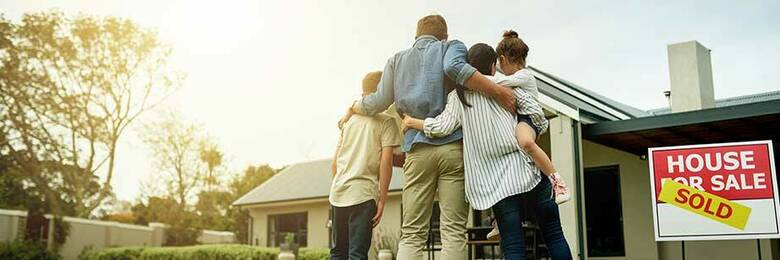 Family looking at their new home.