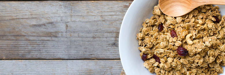 Bowl of muesli with wooden spoon