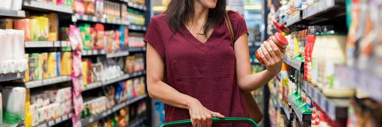 Woman looking at food product label